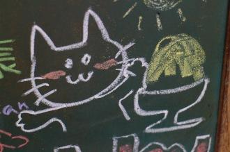 バースデーケーキの黒板の猫